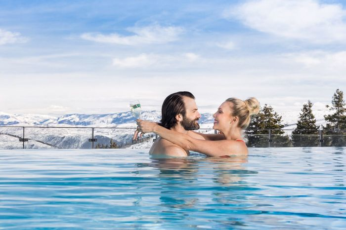 Couple in Pool at Stein Eriksen Residences