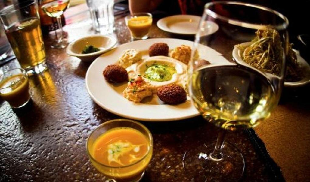 The sample platter at Reefs features classic dishes such as falafel, hummus and baba ganoush.