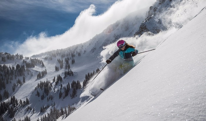 Girl Skiing Down a Powder Bowl