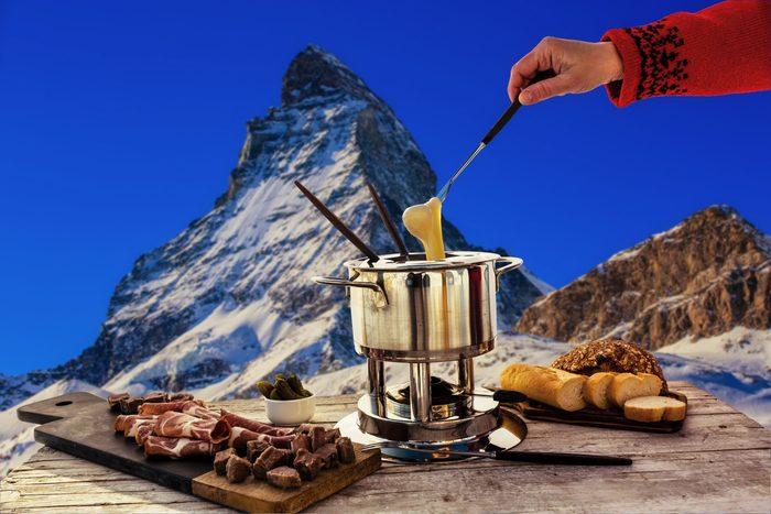 Fondue cheese swiss winter ski holidays break for lunch mountain view Matterhorn in Zermatt Switzerland