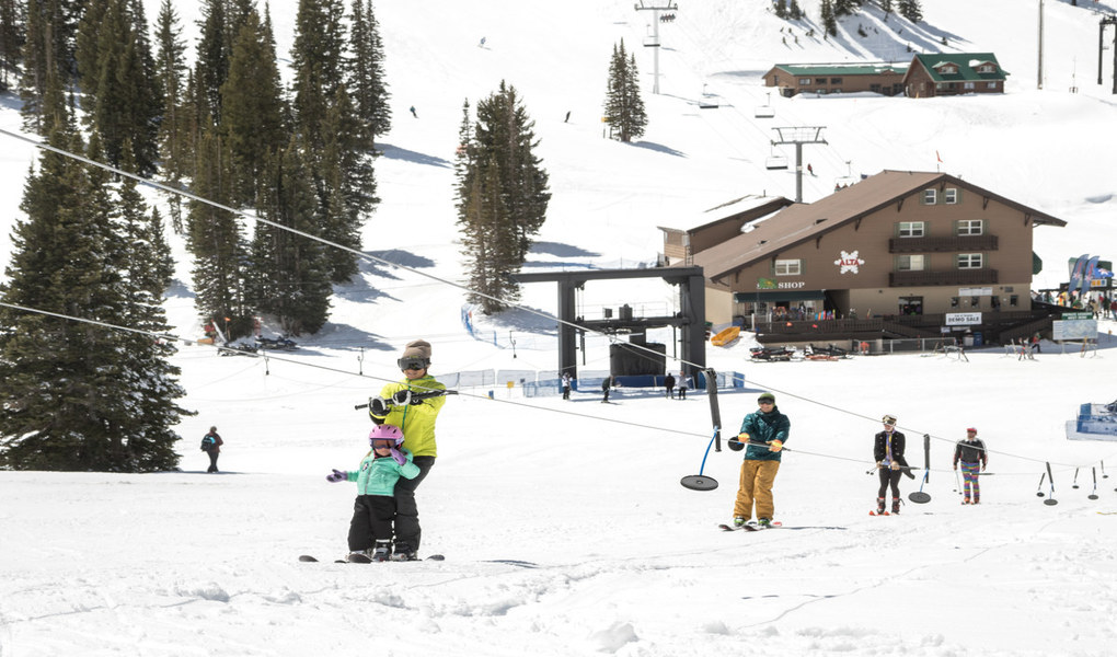 Family skiing at Alta Lodge